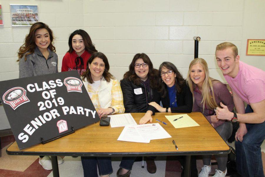Several North seniors stop by the Senior Party signup table. Left to right: Julianne Vang, Dioscelin Suarez, Kathy La Casse, Lisa Wheeler, Lori Hurley, Lydia Olson, Noah Hurley