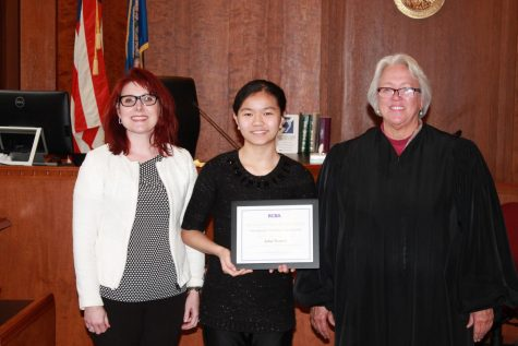 Julia Truong is honored by two Ramsey County judges: left, Judge Jessica Palmer-Denig of the Office of Administrative Hearings; right, retired Ramsey County District Judge Diane Alshouse. (photo: J. Simms)